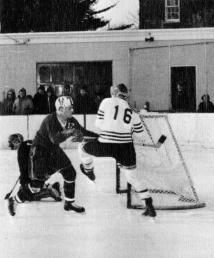 John Ready tangles with a Belmont Hill defenseman, 1966.